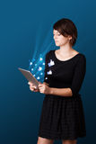 Young woman looking at modern tablet with abstract lights and so Stock Photos