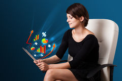 Young woman looking at modern tablet with abstract lights and va Royalty Free Stock Photography