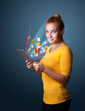 Young woman looking at modern tablet with abstract lights and va Royalty Free Stock Photos