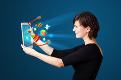 Young woman looking at modern tablet with abstract lights and va Stock Image