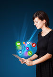 Young woman looking at modern tablet with abstract lights and va Royalty Free Stock Image