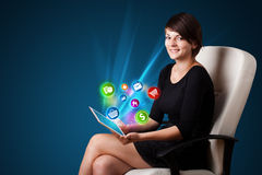 Young woman looking at modern tablet with abstract lights and va Stock Photos
