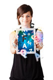 Young woman looking at modern tablet with alphabet Royalty Free Stock Photo