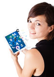 Young woman looking at modern tablet with alphabet Royalty Free Stock Images