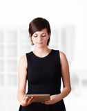 Young woman looking at modern tablet Stock Photo