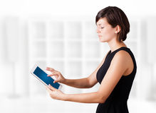 Young woman looking at modern tablet Stock Photography