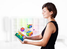 Young woman looking at modern tablet Royalty Free Stock Photography