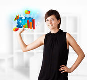 Young woman looking at modern tablet with colourful diagrams Royalty Free Stock Image