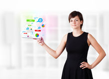 Young woman looking at modern tablet with colourful technology i Royalty Free Stock Photos
