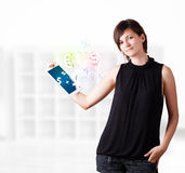 Young woman looking at modern tablet with currency icons. Young business woman looking at modern tablet with currency icons Stock Photo