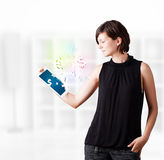 Young woman looking at modern tablet with currency icons Royalty Free Stock Image