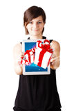 Young woman looking at modern tablet with present boxes Royalty Free Stock Image