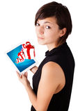 Young woman looking at modern tablet with present boxes Royalty Free Stock Photo