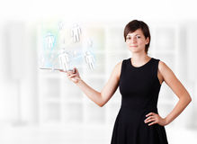Young woman looking at modern tablet with social icons Royalty Free Stock Photography