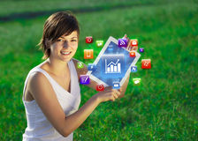 Young woman looking at modern tablet with va Stock Photography