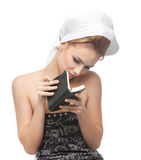 Young woman looking in a notebook Royalty Free Stock Photo