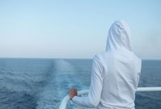 Young woman looking at the ocean. From a fast going liner Stock Photo