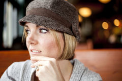 Young Woman Looking Off into the Distance. Young woman in cute brown hat staring off into the distance Stock Photo