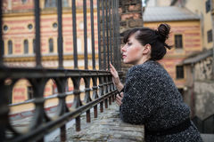 A young woman looking into the old building Royalty Free Stock Photo
