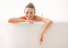 Young woman looking out from bathtub Royalty Free Stock Photos