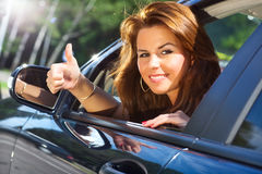 Young woman looking out of car Stock Photo