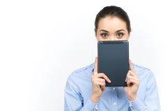 Young woman looking out of digital tablet. Stock Photo
