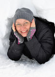 Young Woman Looking out of an Igloo Entrance Stock Photos