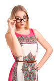 Young woman looking over glasses. Young woman looking at you over glasses Royalty Free Stock Photos