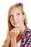 Young woman looking pensive Royalty Free Stock Image
