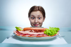 Young woman looking on plate Stock Photography