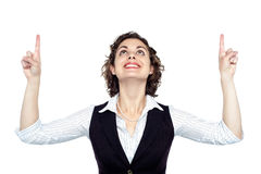 Young woman looking and pointing upwards Royalty Free Stock Photos