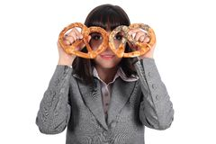 Young woman looking through pretzel royalty free stock images