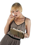 Young woman looking in purse Royalty Free Stock Image