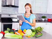 Young woman looking for a recipe online Royalty Free Stock Photo