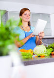 Young woman looking for a recipe online Royalty Free Stock Images