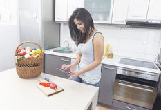 Young woman looking at a Recipe online Stock Image