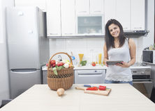 Young woman looking at a Recipe online Royalty Free Stock Image
