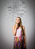 Young woman is looking for a route on the city map. Stock Photo