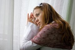 Young woman looking sad Stock Photo