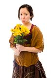 Young woman looking sad with bouquet of sunflowers Royalty Free Stock Image