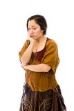 Young woman looking sad with her hand on chin Stock Photography