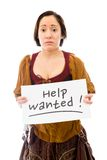 Young woman looking sad and showing help wanted sign on white ba Stock Images