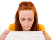 Young woman looking sad was fired from her job. 100 percent pure white background, teen girl is sad Stock Image