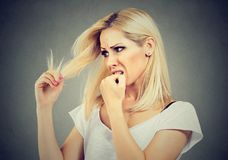 Woman having dilemma with hair Royalty Free Stock Image