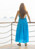 Young woman looking at the sea Stock Photography