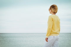 Young woman looking through the sea alone Royalty Free Stock Images