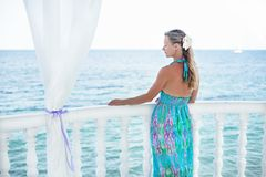 Young woman looking at the sea. Young woman looking at the blue sea Royalty Free Stock Photography