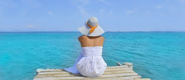 Young woman looking at the sea from a dock Royalty Free Stock Photos