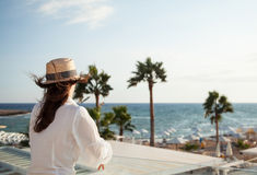 Young woman looking on the sea Stock Photography