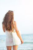 Young woman looking on sea. rear view Royalty Free Stock Photo